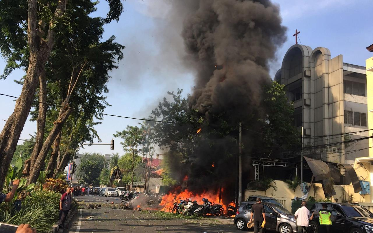 "Dozens of Indonesian mosques are preaching extremism, including violence against non-Muslims, to government workers, the country's intelligence agency has warned.  The alarming findings of the Indonesian State Intelligence Agency follow Indonesia's worst terrorist attack in a decade when three churches and a police station were bombed in the city of Surabaya in May, killing 28 people. Islamic State of Iraq and the Levant (Isil) claimed responsibility for the bombings.  In a chilling development, child suicide bombers were among the attackers in the deadly assault, once again raising fears about the growing influence of hardline Islamism and the decline of religious tolerance in the world's most populous Muslim nation.  According to AFP, the intelligence agency revealed it had probed about 1,000 mosques across the Southeast Asian country since July, and discovered that imams at some 41 places of worship in one neighbourhood in the capital, Jakarta, were preaching extremism to worshippers.  The Surabaya attacks put the Indonesian authorities on alert for extremist attacks Credit: Achmad Ibrahim /AP ""The majority of people who go to these mosques are government workers so that's why this is alarming,"" Wawan Purwanto, the intelligence agency's spokesman, told the newswire. ""These are the people who are running the country."" Intelligence officers found about 17 clerics expressed support of sympathy for Isil and encouraged their congregation to fight for the jihadist group in Syria and Marawi, the southern Philippine city that was destroyed in 2017 after it was besieged by foreign Isil fighters.  More than 600 Indonesians, including at least 166 women and children, travelled to Syria to join Isil, according to data released earlier this year by the Indonesian authorities.  Other preachers urged their followers to commit violence on behalf of the jihadist group, and spread hatred to vilify Indonesia's minority religions, which include Christianity, Buddhism and Hinduism.  Details were not released about the agency's findings at hundreds of other mosques outside of Jakarta.  Concerns have been rising in recent years about the growing influence of extremist groups in Indonesia, a sprawling archipelago that is home to 260 million people.  Supporters of Indonesia's Christian governor, ""Ahok"", protest his conviction in May 2017 for blasphemy Credit: Dita Alangkara/AP Last year, the Christian minority was left reeling in shock after the controversial jailing of the former governor of Jakarta, Basuki Tjahaja Purnama – known by his nickname Ahok – on blasphemy charges.  The conviction of a prominent member of the Christian community followed months of large-scale protests by the Islamic Defenders Front, a hardline group with a record of violence and intimidation, which had previously argued that a Christian should not govern a Muslim-majority city.  Ahok was accused of insulting Islam on the campaign trail but he insisted that his comments had been misinterpreted.  His case highlighted the challenges faced by the government and judiciary in tackling extremist groups which are capable of influencing large sections of the electorate, despite constitutional guarantees on freedom of religion.  President Joko Widodo faces a tough re-election battle in 2019 in a country which ranges widely from the more liberal holiday paradise of Bali to Aceh province, which is ruled by Sharia law and where citizens can be caned for having sex outside of marriage or for selling alcohol."