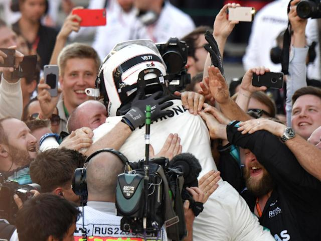 Bottas celebrates with the crowd after securing victory (Getty)