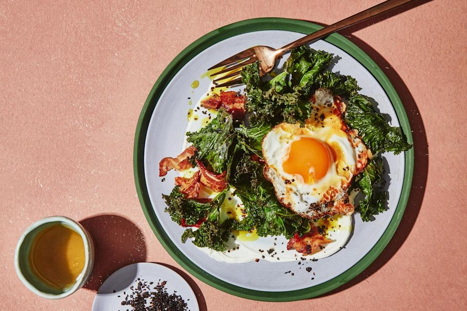 "Turmeric oil–basted eggs team up with crispy bacon and charred kale, then get served over a bed of salted yogurt for this 20-minute breakfast bowl. <a href=""https://www.epicurious.com/recipes/food/views/turmeric-eggs-with-kale-yogurt-and-bacon?mbid=synd_yahoo_rss"" rel=""nofollow noopener"" target=""_blank"" data-ylk=""slk:See recipe."" class=""link rapid-noclick-resp"">See recipe.</a>"