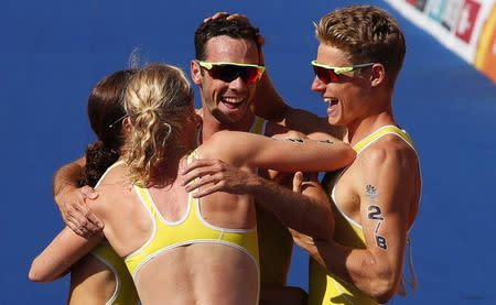 Triathlon - Gold Coast 2018 Commonwealth Games - Mixed Team Relay Final - Southport Broadwater Parklands - Gold Coast, Australia - April 7, 2018. Australia team members celebrate their win. REUTERS/David Gray