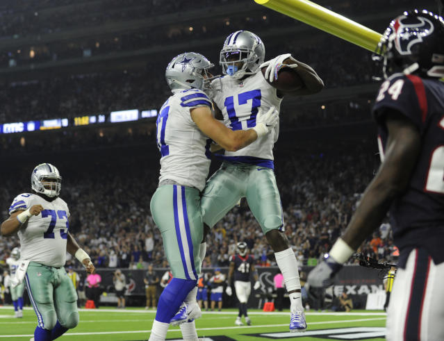 Dallas Cowboys wide receiver Allen Hurns (17) celebrates his touch down catch with teammate Geoff Swaim (87) during the second half of an NFL football game against the Houston Texans, Sunday, Oct. 7, 2018, in Houston. (AP Photo/Eric Christian Smith)