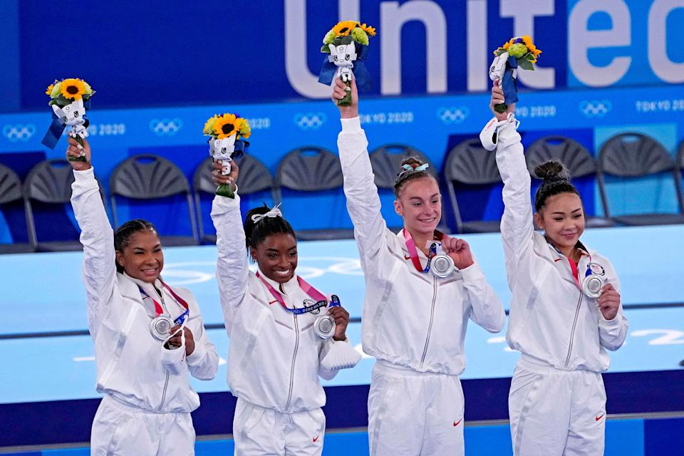 Jordan Chiles, Simone Biles, Grace McCallum and Sunisa Lee of the United States celebrate after winning the silver medal in the women's team final during the Tokyo 2020 Olympic Summer Games at Ariake Gymnastics Centre on July 27, 2021.