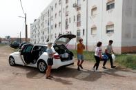 Volunteers of East Algarve Families in Need Food Bank deliver food to a needy family, during the coronavirus disease (COVID-19) pandemic in Tavira