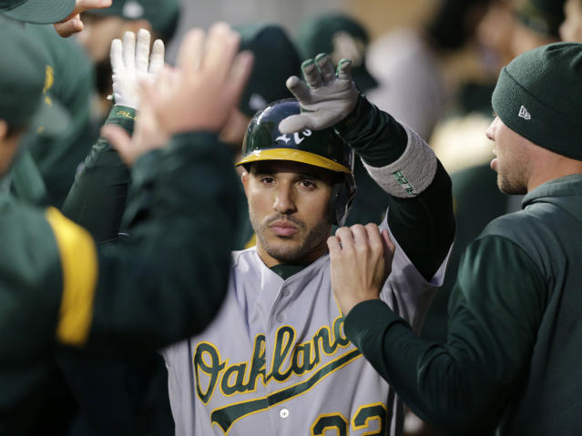 Oakland Athletics' Ramon Laureano makes his way through the dugout after hitting a solo home run on a pitch from Seattle Mariners' Marco Gonzales during the third inning of a baseball game, Saturday, Sept. 28, 2019, in Seattle. (AP Photo/John Froschauer)