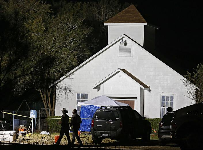 <p>Two Texas State Troopers walk past the church while investigators work at the scene of a mass shooting at the First Baptist Church in Sutherland Springs, Texas, Nov. 5, 2017. (Photo: Larry W. Smith/EPA-EFE/REX/Shutterstock) </p>