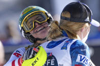 Austria's Katharina Liensberger, face to camera, winner of the women's slalom, celebrates with third placed United States' Mikaela Shiffrin, at the alpine ski World Championships in Cortina d'Ampezzo, Italy, Saturday, Feb. 20, 2021. (AP Photo/Giovanni Auletta)