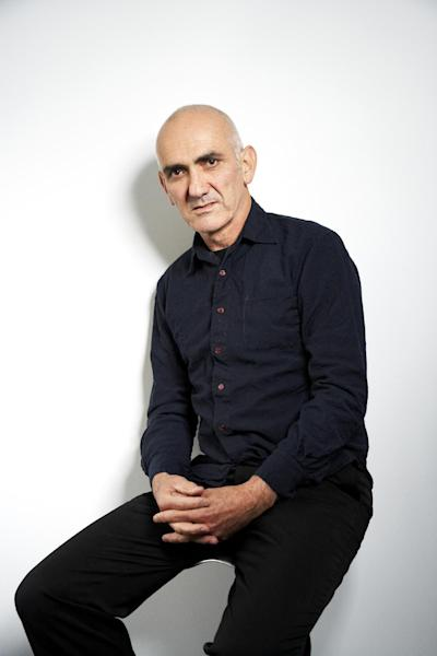 "FILE - This Jan. 23, 2013 file photo shows Australian singer-songwriter Paul Kelly posing for a portrait in New York. The veteran Australian singer made a song cycle, ""Spring and Fall,"" that traces a love affair from the beginning to beyond its end. He'll perform it during a six-week American tour that begins Saturday in Santa Barbara, Calif. (Photo by Dan Hallman/Invision/AP, file)"