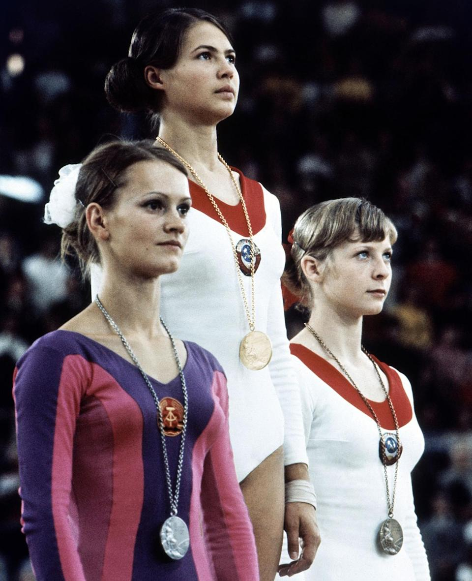 <p>On the podium on Aug. 30, 1972 in Munich, after women's individual gymnastics are gold medalist Ludmilla Tourischeva of Russia, flanked on the left by Janz Karin of Germany winning silver, and Tamara Lazakovitch of USSR. (AP Photo) </p>