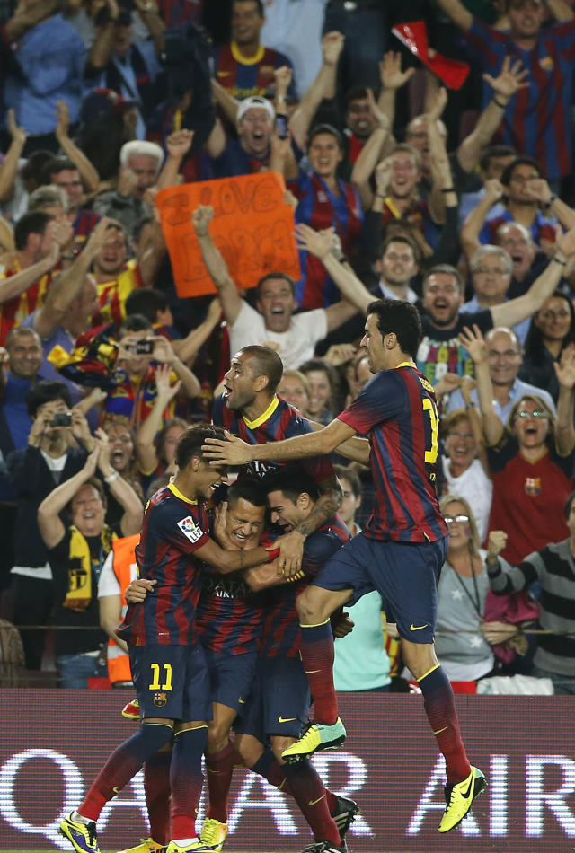 Barcelona's Alexis Sanchez, centre, celebrates with teammates after scoring during a Spanish La Liga soccer match between Barcelona F.C. and Real Madrid at the Camp Nou stadium in Barcelona, Spain, Saturday, Oct. 26, 2013. (AP Photo/Emilio Morenatti)