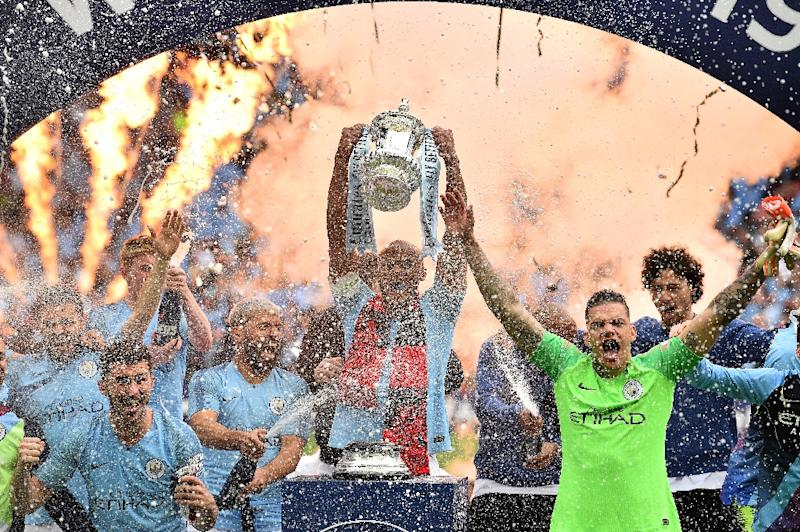 10 in 10: Manchester City's FA Cup win was their 10th major trophy win in a decade under the club's Abu Dhabi ownership (AFP Photo/Glyn KIRK                          )