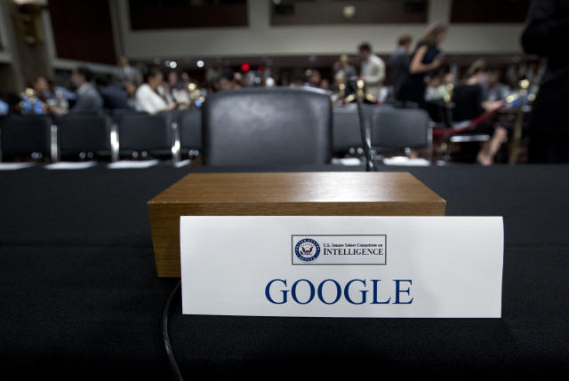 An empty chair reserved for Google's parent Alphabet, which refused to send its top executive. (AP Photo/Jose Luis Magana)