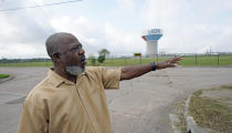 """Activist Hilton Kelley talks about the neighborhood where he grew up Monday, March 23, 2020, in Port Arthur, Texas. Kelley says he started speaking out for Port Arthur's black community when he got fed up """"always hearing about someone dying of cancer, always smelling smells, watching little babies using nebulizers."""" (AP Photo/David J. Phillip)"""
