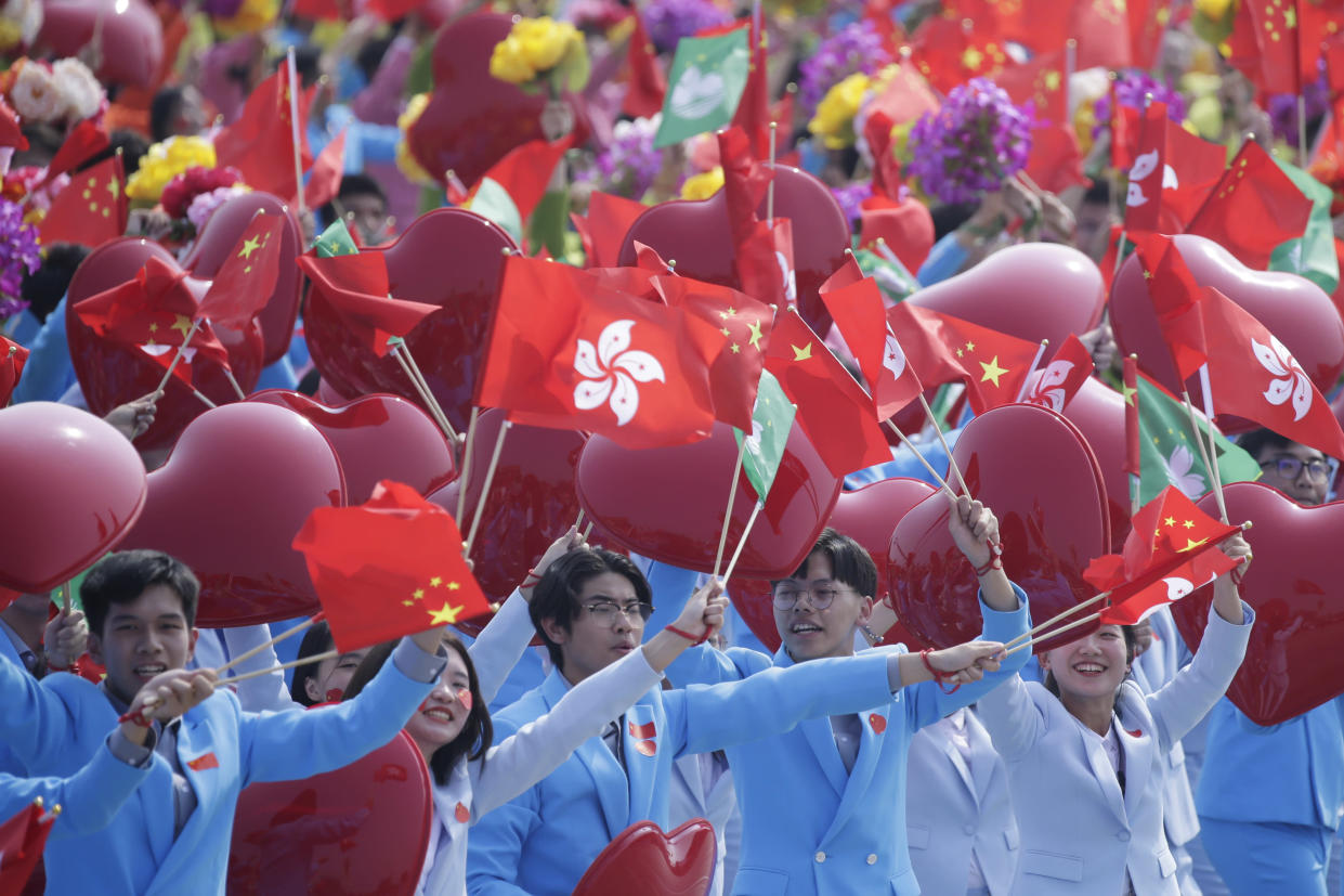 Performers wave Chinese, Hong Kong and Macau flags during the parade marking the 70th founding anniversary of People's Republic of China, on its National Day in Beijing, China October 1, 2019. (Photo: Jason Lee/Reuters)