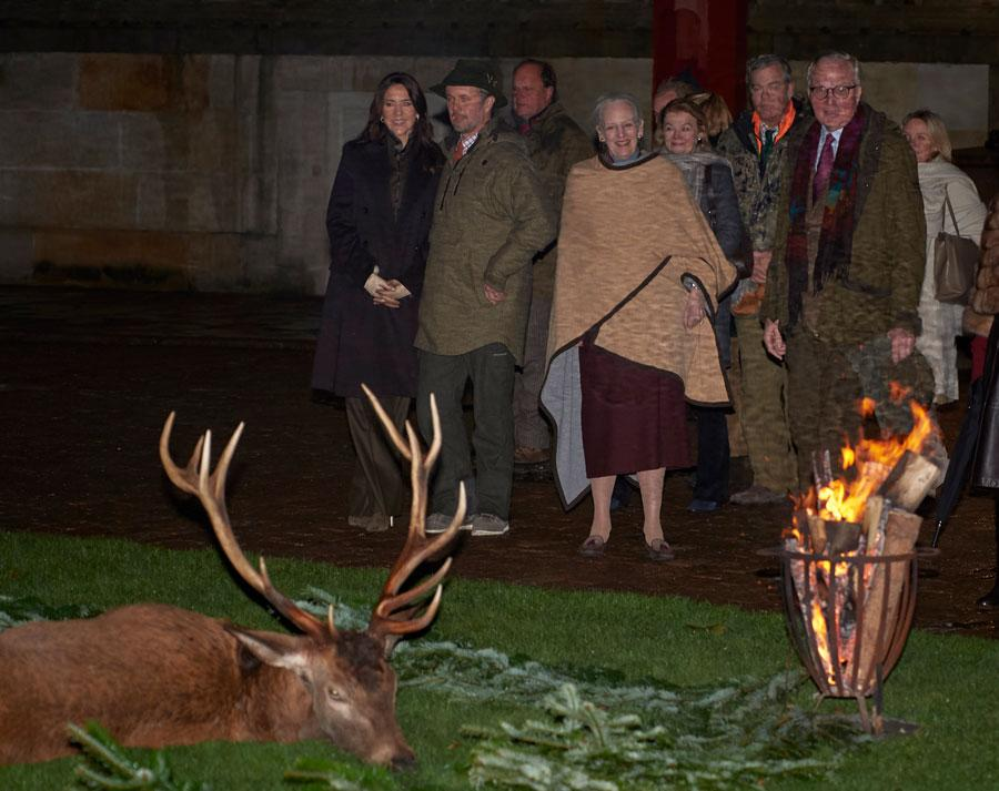 A photo of Crown Princess Mary and her husband, Crown Prince Frederik, along with Queen Margrethe at the hunting parade.