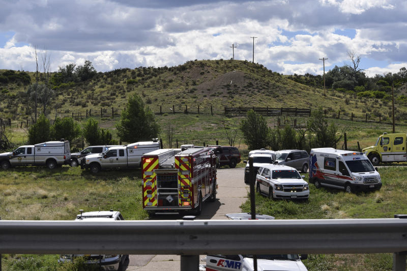 Emergency crews respond to a bus crash on southbound Interstate 25 in Pueblo County, Colo., Sunday afternoon, June 23, 2019. A charter bus carrying more than a dozen people ran off the highway after striking a bridge support Sunday in southern Colorado, killing a few people and injuring several others, a state patrol official said. (Zach Hillstrom/The Pueblo Chieftain via AP)