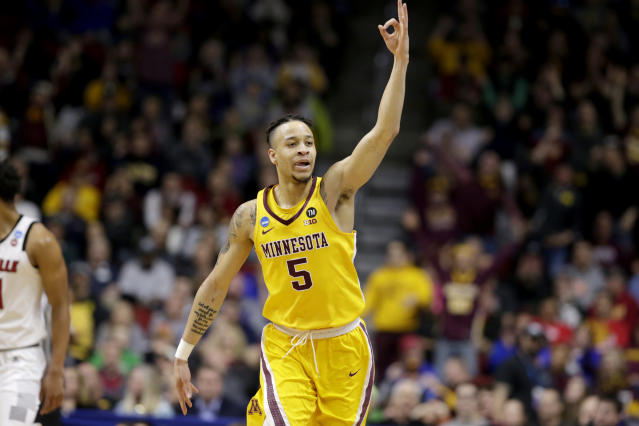 Minnesota's Amir Coffey (5) celebrates a three-point basket during the first half of a first round men's college basketball game against Louisville in the NCAA Tournament, in Des Moines, Iowa, Thursday, March 21, 2019. (AP Photo/Nati Harnik)