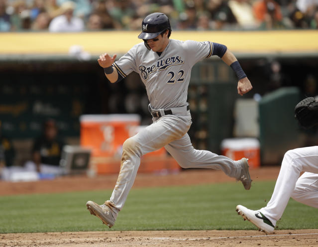 Milwaukee Brewers' Christian Yelich scores against the Oakland Athletics in the seventh inning of a baseball game Thursday, Aug. 1, 2019, in Oakland, Calif. (AP Photo/Ben Margot)