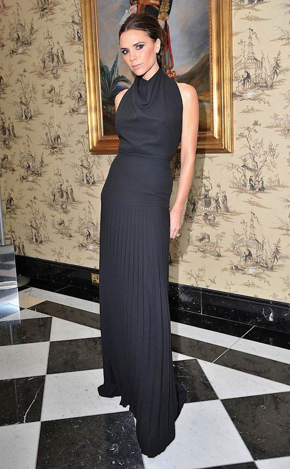 Across the pond, Victoria Beckham struck a fierce pose in a black pleated halter gown of her own design at the British Fashion Awards, where she was named the Designer Brand of the Year. (11/28/2011)