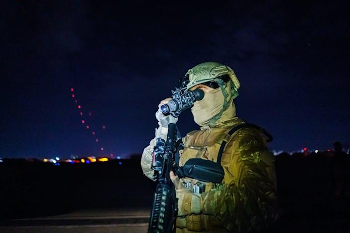 """<span class=""""caption"""">A Taliban fighter, wearing U.S. clothing and carrying U.S. weapons, looks through a captured night-vision device.</span> <span class=""""attribution""""><a class=""""link rapid-noclick-resp"""" href=""""https://www.gettyimages.com/detail/news-photo/taliban-fighters-from-the-fateh-zwak-unit-wielding-american-news-photo/1234968813"""" rel=""""nofollow noopener"""" target=""""_blank"""" data-ylk=""""slk:Marcus Yam/Los Angeles Times via Getty Images"""">Marcus Yam/Los Angeles Times via Getty Images</a></span>"""