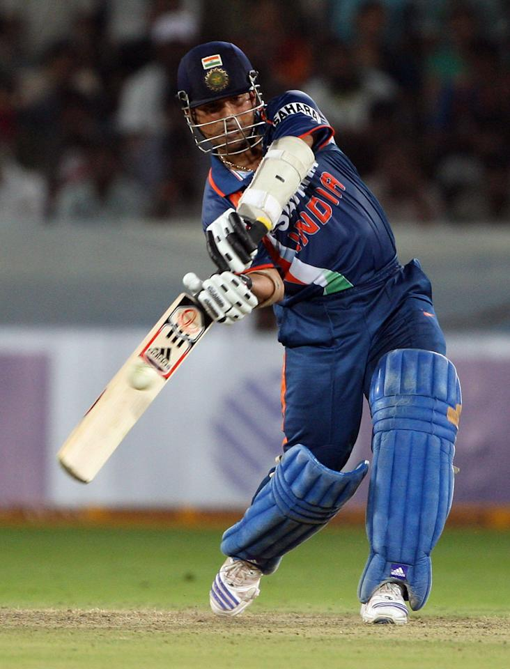 HYDERABAD, INDIA - NOVEMBER 05:  Sachin Tendulkar of India hits out during the fifth One Day International match between India and Australia at Rajiv Gandhi International Cricket Stadium on November 5, 2009 in Hyderabad, India.  (Photo by Mark Kolbe/Getty Images)