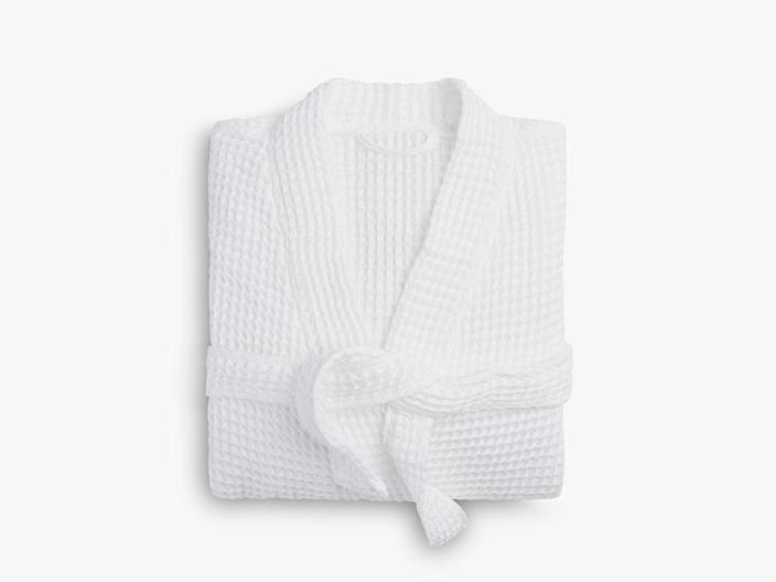 """For the dad who's into self-care, a spa-quality robe to help him feel just as pampered at home. $119, Parachute. <a href=""""https://www.parachutehome.com/products/waffle-robe?opt-color=white"""" rel=""""nofollow noopener"""" target=""""_blank"""" data-ylk=""""slk:Get it now!"""" class=""""link rapid-noclick-resp"""">Get it now!</a>"""