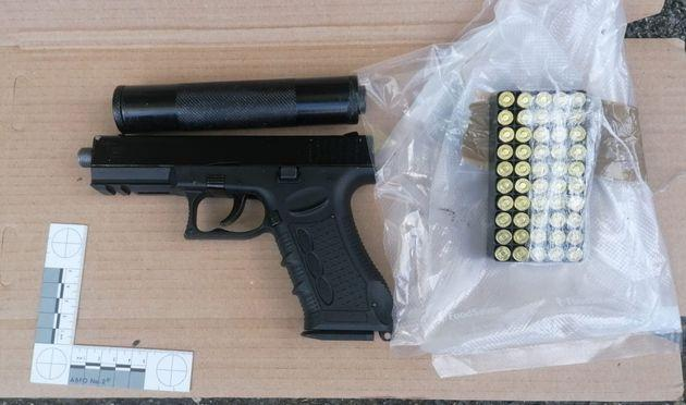 Undated handout photo issued by the Metropolitan Police of a firearm and ammunition seized in Operation Venetic.