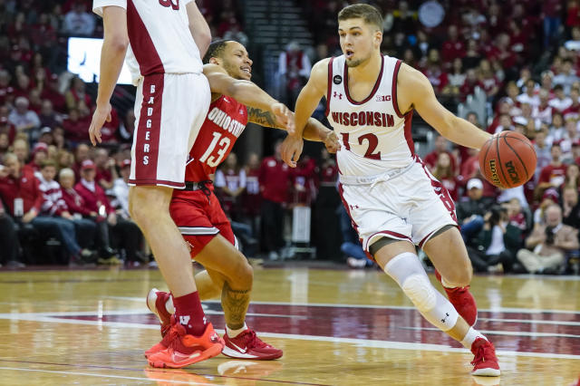 Wisconsin's Trevor Anderson (12) drives against Ohio State's CJ Walker (13) during the second half of an NCAA college basketball game Sunday, Feb. 9, 2020, in Madison, Wis. (AP Photo/Andy Manis)