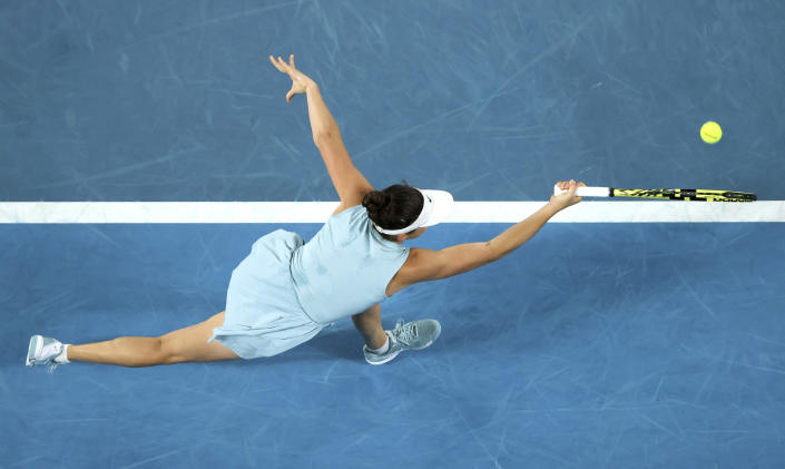 United States' Jennifer Brady hits a forehand return to Japan's Naomi Osaka during the women's singles final at the Australian Open tennis championship in Melbourne, Australia, Saturday, Feb. 20, 2021.(AP Photo/Hamish Blair)