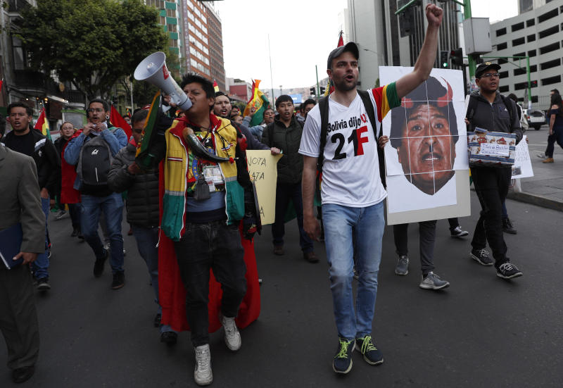 Anti-government protesters hold a picture of Bolivia's President Evo Morales, during a march demanding a second round presidential election, in La Paz, Bolivia, Saturday, Oct. 26, 2019. Bolivia's official vote tally was revealed Friday pointing to an outright win for incumbent Evo Morales in a disputed presidential election that has triggered protests and growing international pressure on the Andean nation to hold a runoff ballot. (AP Photo/Juan Karita)