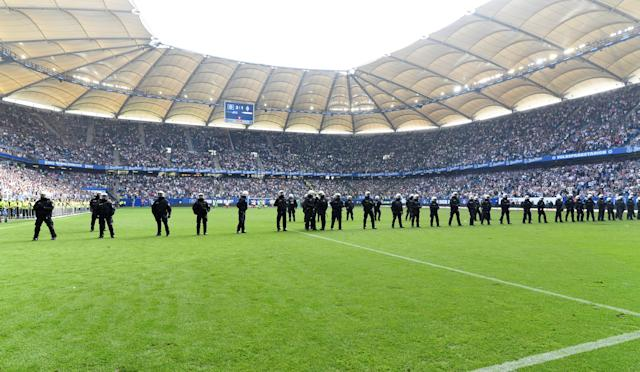Soccer Football - Bundesliga - Hamburger SV v Borussia Moenchengladbach - Volksparkstadion, Hamburg, Germany - May 12, 2018 Riot police lined up across the pitch at the end of the match REUTERS/Fabian Bimmer DFL RULES TO LIMIT THE ONLINE USAGE DURING MATCH TIME TO 15 PICTURES PER GAME. IMAGE SEQUENCES TO SIMULATE VIDEO IS NOT ALLOWED AT ANY TIME. FOR FURTHER QUERIES PLEASE CONTACT DFL DIRECTLY AT + 49 69 650050