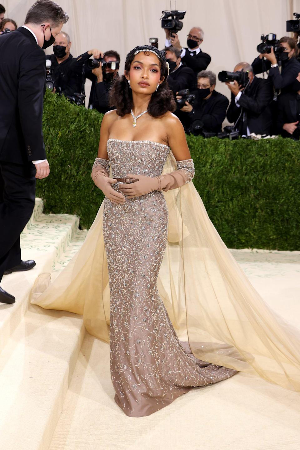 <p>Wearing a custom Dior gown and Cartier jewels. </p>