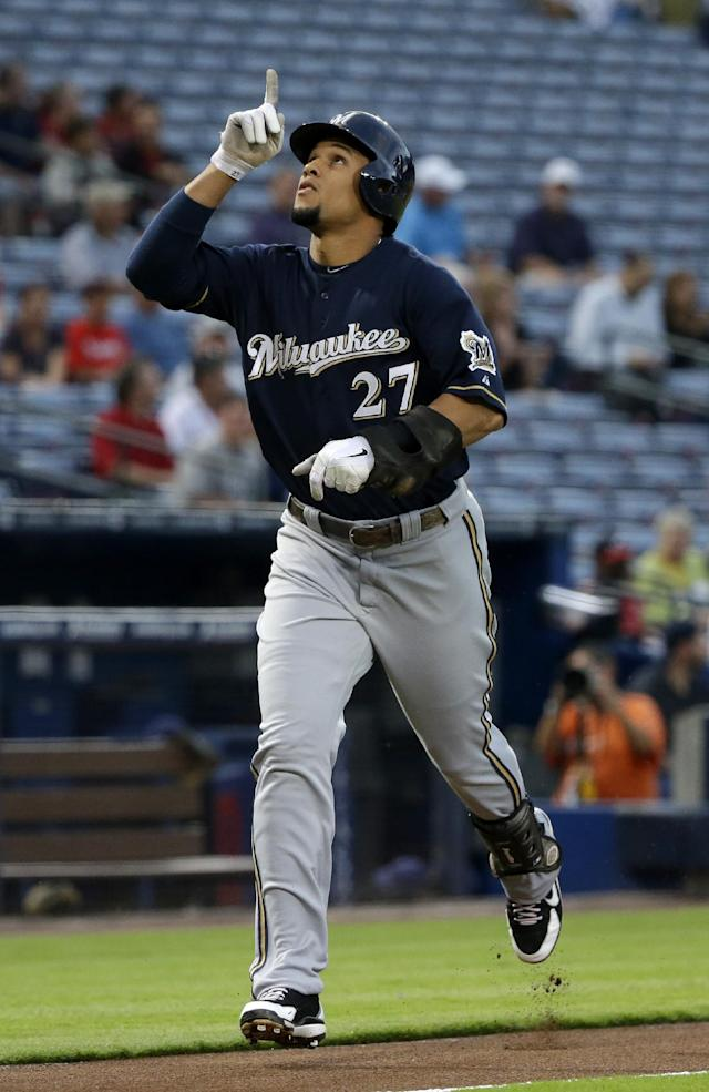 Milwaukee Brewers' Carlos Gomez points to the sky as he runs to home plate after hitting a home run in the first inning of a baseball game against the Atlanta Braves, Monday, Sept. 23, 2013, in Atlanta. (AP Photo/David Goldman)