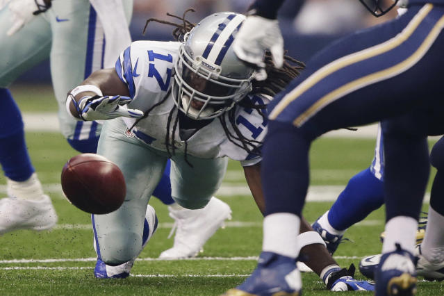 Dallas Cowboys wide receiver Dwayne Harris (17) fumbles a punt return against the St. Louis Rams during the first quarter of a NFL football game Sunday, Sept. 22, 2013, in Arlington, Texas. (AP Photo/Tony Gutierrez)