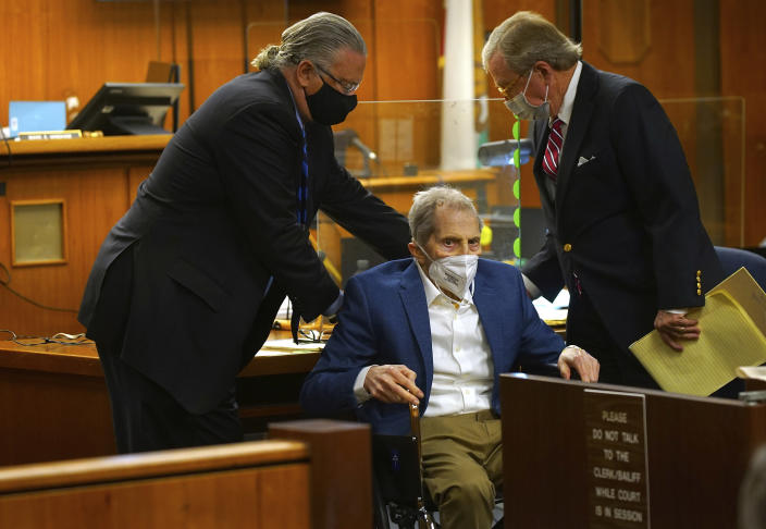 Defense attorney's Dick DeGuerin, right, and David Z. Chesnoff, left, adjust Robert Durst's wheelchair as he faced jurors in the courtroom of Judge Mark E. Windham as attorneys begin opening statements in the trial of the real estate scion charged with murder of longtime friend Susan Berman, at Los Angeles County Superior Court, Tuesday, May 18, 2021, in Inglewood, Calif. Durst's murder trial was delayed more than a year due to the Covid-19 pandemic. (Al Seib/Los Angeles Times via AP, Pool)