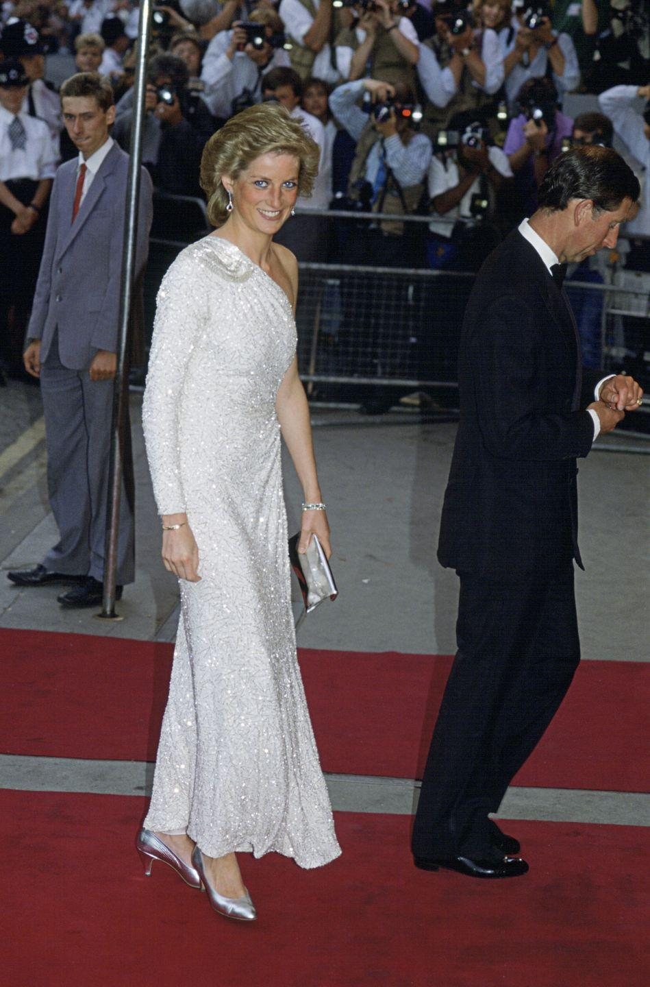 <p>Princess Diana seemed to be a fan of the Bond movies, as she attended many of their premieres during her life time. Here, she was photographed attending the <em>A License To Kill </em>premiere, wearing a white asymmetric gown from Japanese designer Hachi<em>.</em></p>