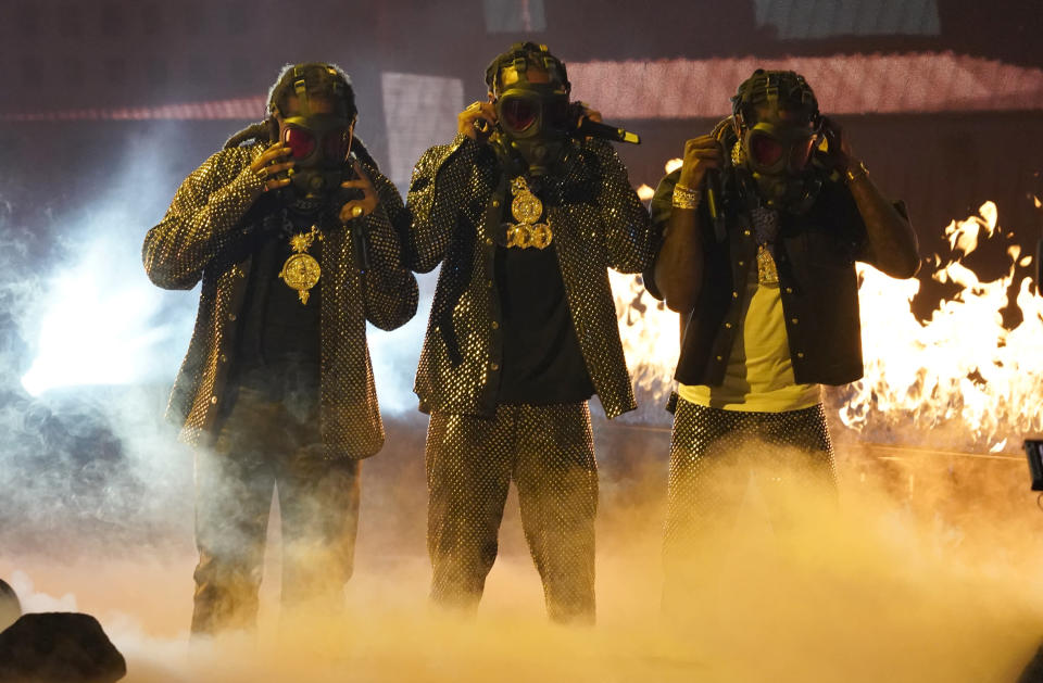 Takeoff, from left, Quavo and Offset, of Migos, perform at the BET Awards on Sunday, June 27, 2021, at the Microsoft Theater in Los Angeles. (AP Photo/Chris Pizzello)