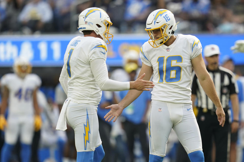 Los Angeles Chargers kicker Tristan Vizcaino right, celebrates with punter Ty Long after making a field goal during the second half of an NFL football game Sunday, Sept. 19, 2021, in Inglewood, Calif. (AP Photo/Ashley Landis)