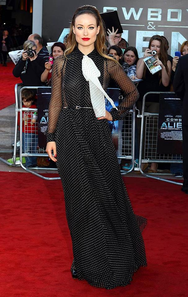 """Olivia Wilde is either hit or miss, and suffice it to say, she definitely missed at the UK premiere of """"Cowboys & Aliens"""" because of that polka dot bib. Sans scarf, her Gucci gown may have been tolerable. Mike Marsland/<a href=""""http://www.wireimage.com"""" target=""""new"""">WireImage.com</a> - April 11, 2011"""