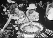 <p>Jake Freedman, the owner of the Sands hotel, at a roulette table. He was often seen wearing matching cowboy-inspired outfits with his wife, Carolyn, because, why not?</p>