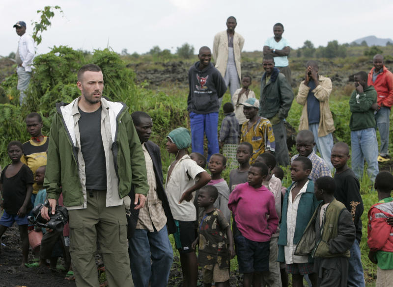 """FILE - This Nov. 19, 2008 file photo shows actor/director Ben Affleck walking through a camp for displaced people near Kibati just north of Goma in eastern Congo. Affleck is managing to live a relatively private life in a Hollywood fishbowl. He married Jennifer Garner, had three kids, and cut down his """"compulsive"""" work schedule to be with his family. He also founded the Eastern Congo Initiative in an effort to reduce the child mortality rate in the Congo. (AP Photo/Karel Prinsloo, file)"""