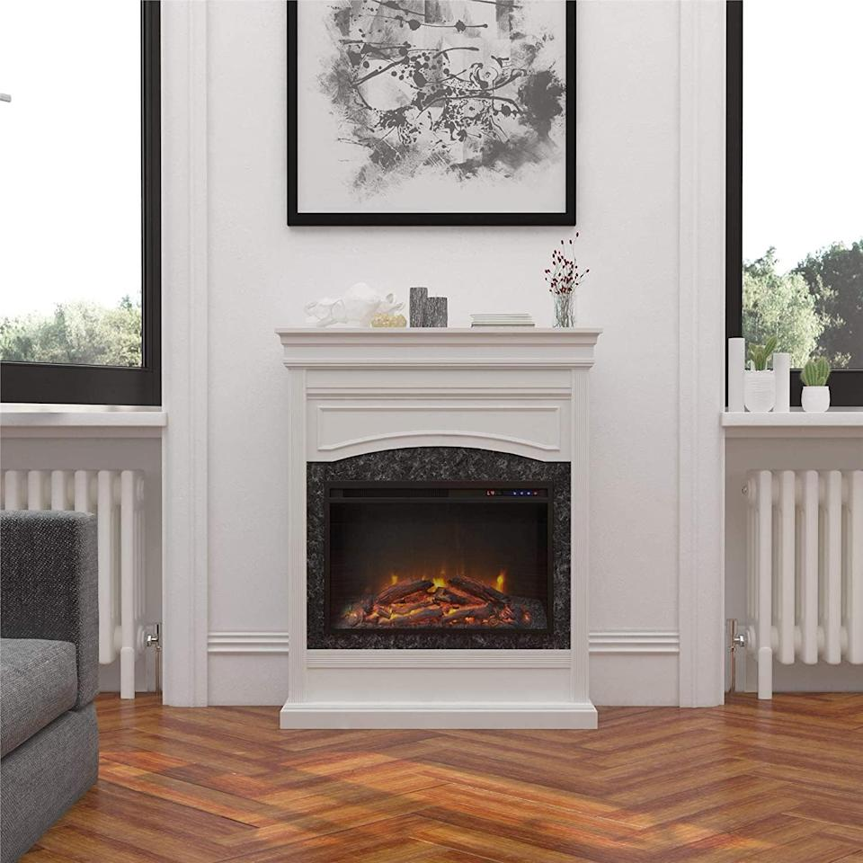 <p>Stay cozy with this cute <span>Ameriwood Home Lamont Electric White Fireplace</span> ($530), that you could even hang stockings off of!</p>