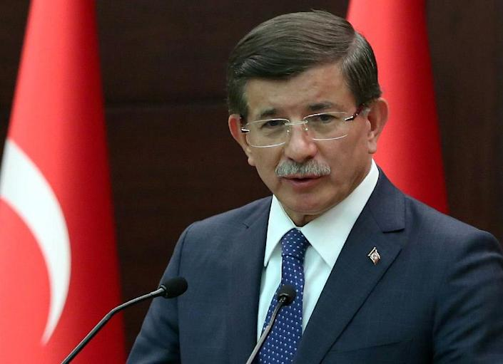 """Turkish Prime Minister Ahmet Davutoglu (pictured) said one suspect over the Suruc suicide bombing had been identified, adding there was a """"high probability"""" the attack was caused by a suicide bomber with connections to IS jihadists (AFP Photo/Halil Sagirkaya)"""