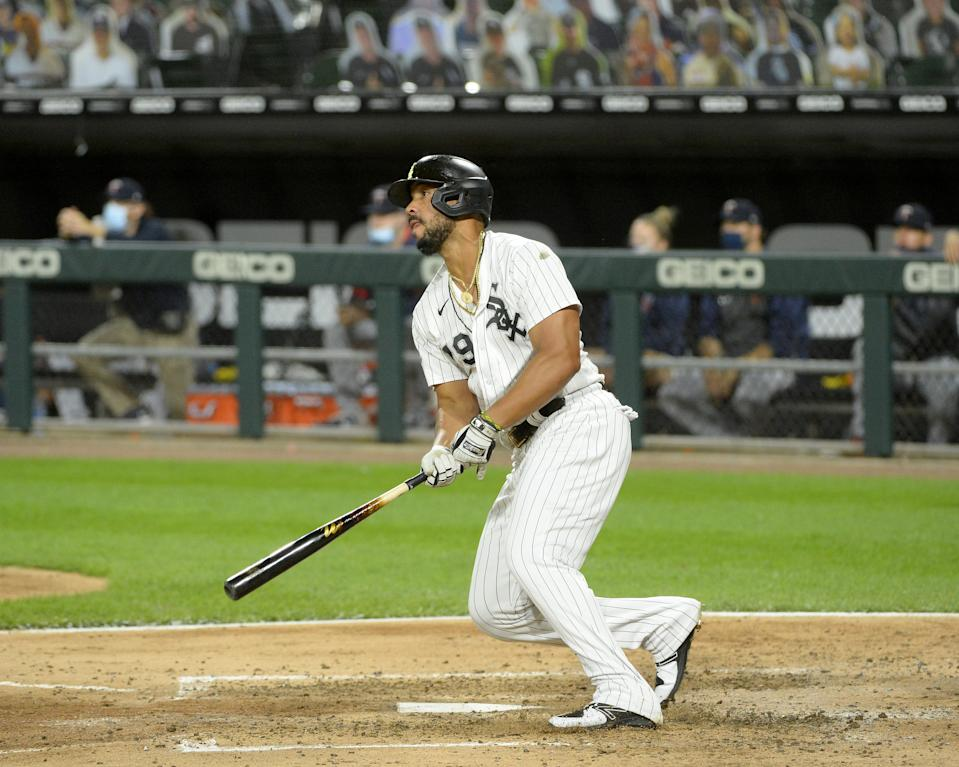 CHICAGO - SEPTEMBER 16:  Jose Abreu #79 of the Chicago White Sox hits a home run after a high inside pitch sailed by his head earlier in the same at bat against the Minnesota Twins on September 16, 2020 at Guaranteed Rate Field in Chicago, Illinois.  (Photo by Ron Vesely/Getty Images)