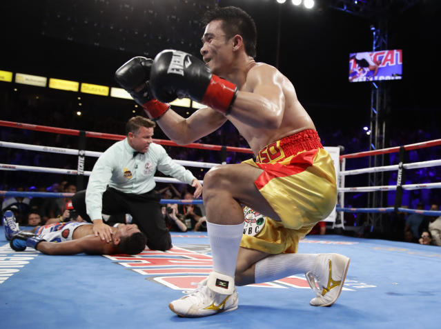 Srisaket Sor Rungvisai, of Thailand, celebrates after knocking out Roman Gonzalez of Nicaragua, during the fourth round of their WBC super flyweight championship boxing match Saturday, Sept. 9, 2017, in Carson, Calif. (AP)