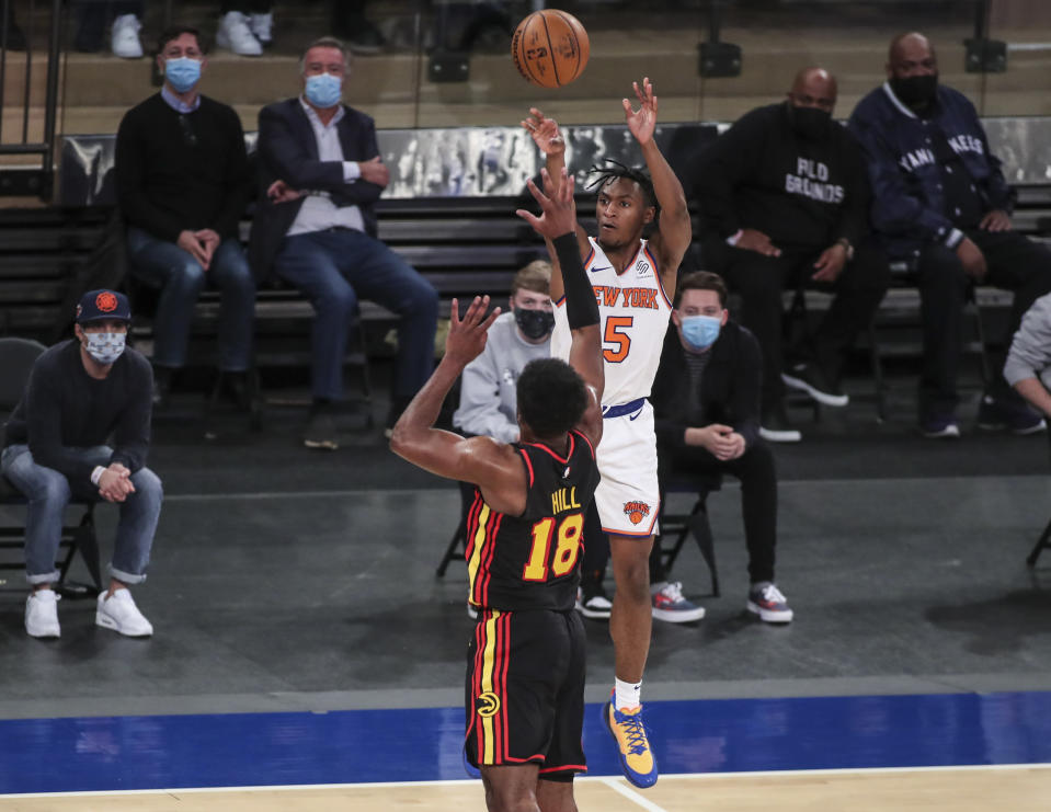 New York Knicks guard Immanuel Quickley (5) shoots against the Atlanta Hawks during overtime in an NBA basketball game Wednesday, April 21, 2021, in New York. (Wendell Cruz/Pool Photo via AP)