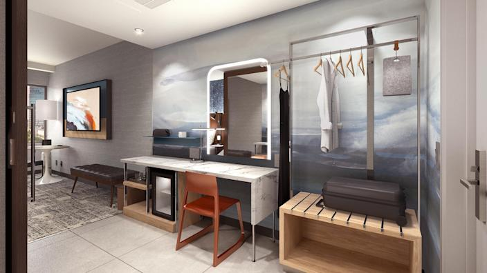 "The ""Get Ready Zone"" in each room is a dedicated space for guests to prepare for their day with a lit vanity and storage keep their belongings organized. Rendering by: Hilton."