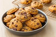 """<p>Halloween is the perfect excuse to bake these cookies that you'll want to eat all season long. You're welcome!</p><p><em><a href=""""https://www.delish.com/cooking/recipe-ideas/recipes/a55742/pumpkin-spice-chocolate-chip-cookies-recipe/"""" rel=""""nofollow noopener"""" target=""""_blank"""" data-ylk=""""slk:Get the recipe from Delish »"""" class=""""link rapid-noclick-resp"""">Get the recipe from Delish »</a></em></p>"""