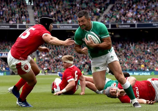 Rob Kearney goes past Wales' Leigh Halfpenny to score Ireland's fourth try in the 19-10 victory (Brian Lawless/PA)