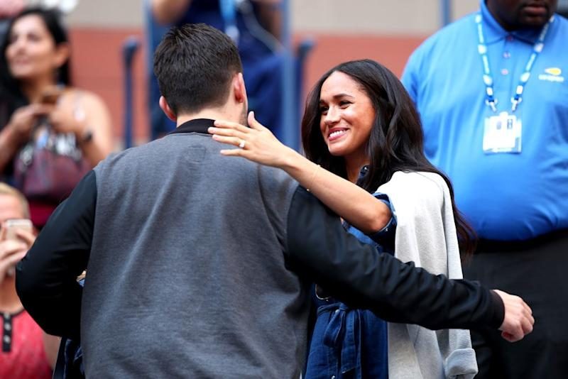 NEW YORK, NEW YORK - SEPTEMBER 07: (L-R) Alexis Ohanian, entrepreneur and husband of Serena Williams, embraces Meghan, Duchess of Sussex, before the Women's Singles final match between Serena Williams of the United States and Bianca Andreescu of Canada on day thirteen of the 2019 US Open at the USTA Billie Jean King National Tennis Center on September 07, 2019 in the Queens borough of New York City. (Photo by Clive Brunskill/Getty Images)