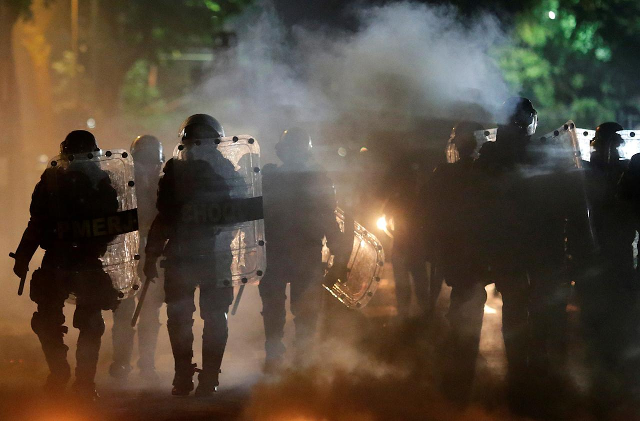 <p>Riot police walk past a barricade on fire after a clash with ant-government demonstrators during a protest against Brazilian social welfare reforms, in Rio de Janeiro, Brazil, March 15, 2017. (Ricardo Moraes/Reuters) </p>